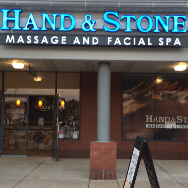 Hand and Stone store sign